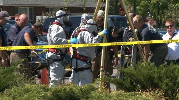 Police, fire and hazmat crews investigate a suspected meth lab found in a sewer under the parking lot of a Walmart in Amherst, New York. (WGRZ)