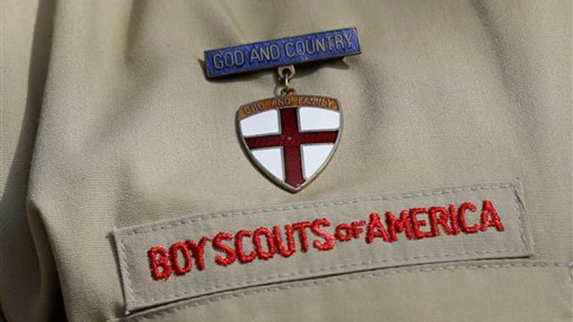 This photo taken Monday, Feb. 4, 2013, shows a close up detail of a Boy Scout uniform. (AP Photo/Tony Gutierrez)