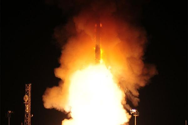In this photo provided by the U.S. Air Force, an unarmed Minuteman 3 missile launches on Wednesday, Aug. 19, 2015, at Vandenberg Air Force Base, Calif. (Joe Davila/U.S. Air Force via AP)