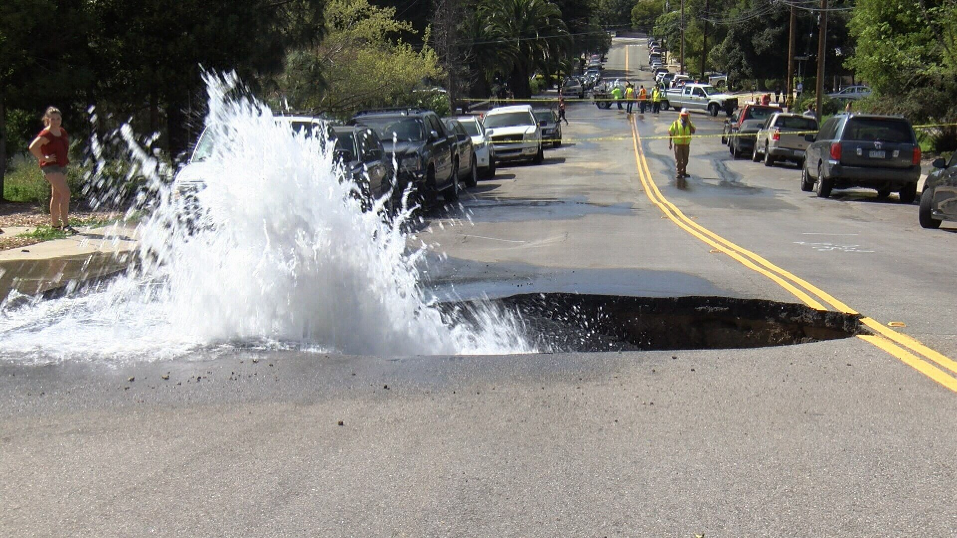 Water flows from a sinkhole on Fredericks Street. (KSBY photo)