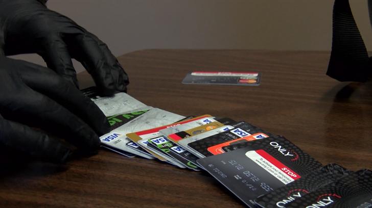 San Luis Obispo police display fraudulent credit and debit cards. (KSBY photo)