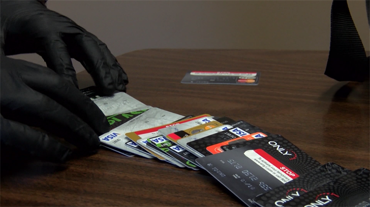 San Luis Obispo police display fraudulent credit and debit cards. (KSBY photo)