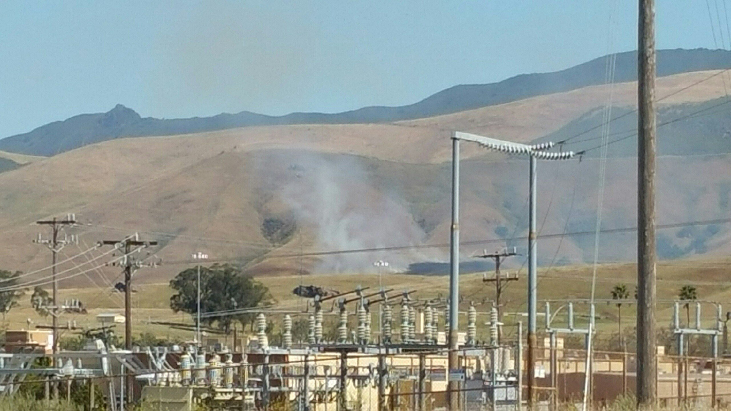 Smoke is seen from a fire at Camp San Luis Obispo. (KSBY photo)