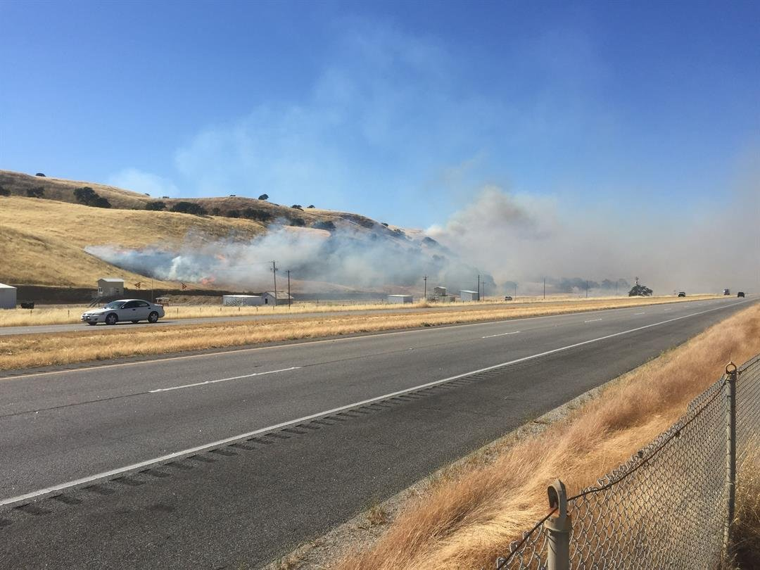 A fire burns at Camp Roberts near Highway 101. (KSBY photo)