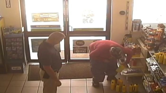Security cameras show Florida man apprehended with 15 quart bottles of motor oil and 30 DVDs in his pants. (NBC photo)