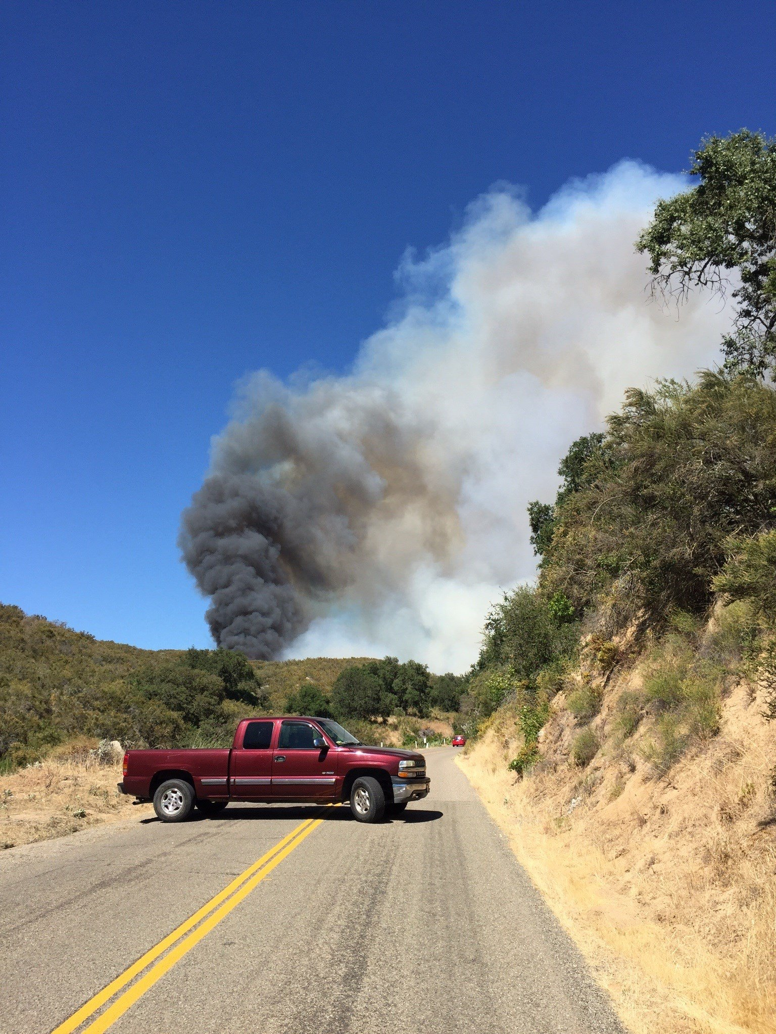 Parkhill Road is closed to traffic because of the fire. (KSBY photo)