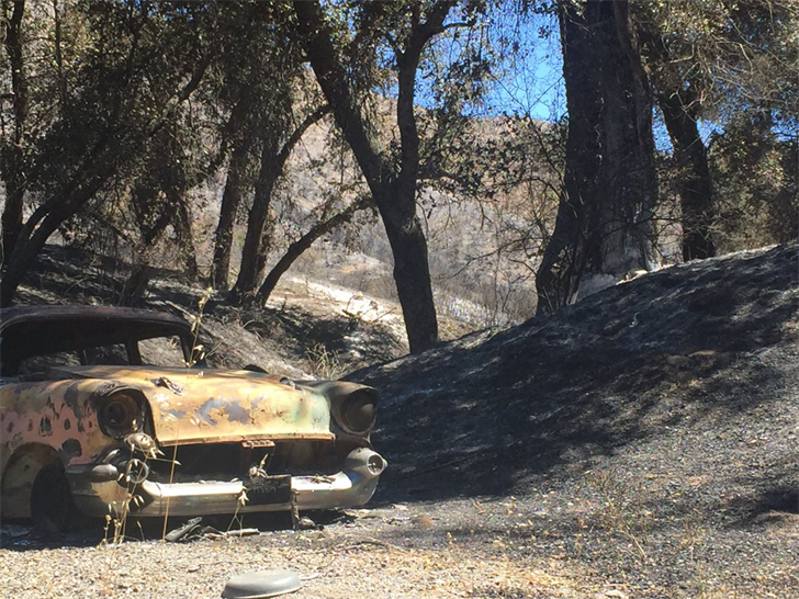 A car along Stagecoach Canyon Road was burned in the fire. (KSBY photo)