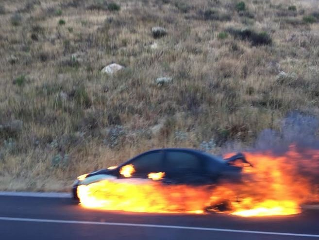 A vehicle caught fire on the Cuesta Grade Saturday morning. (Photo: Peter Reilly)