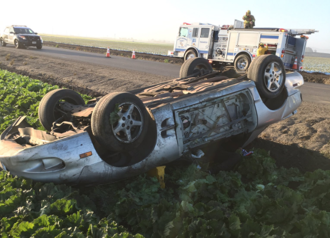 Officials say the car rolled before landing in a field on its roof, killing the driver. (SB Co. Fire photo)