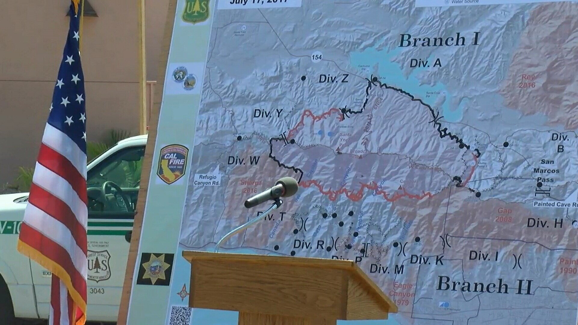 Fire crews working on the Whittier Fire meet for the latest update. (KSBY Photo)