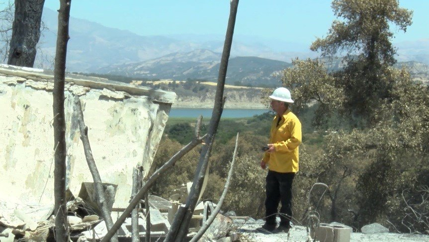 Jeff Gater, Santa Barbara County Emergency Manager, looks over a structure destroyed by the Whittier Fire. (KSBY photo)