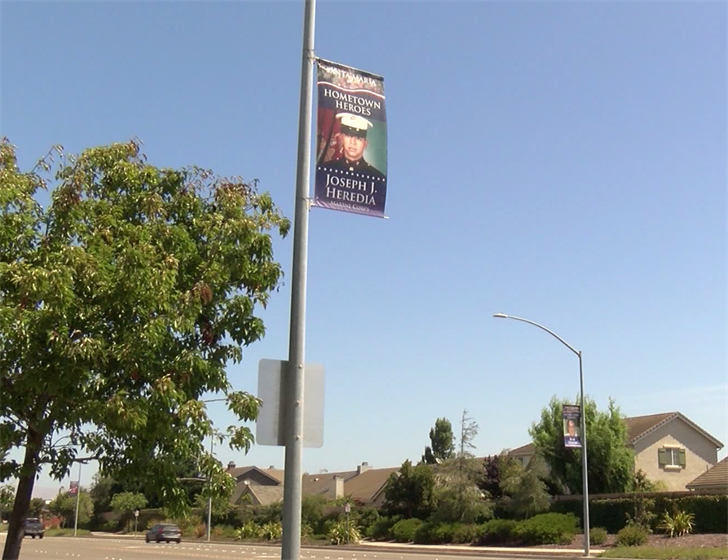 Each Hometown Hero banner will be up for six months before being given to their families for keepsakes. (KSBY Photo)