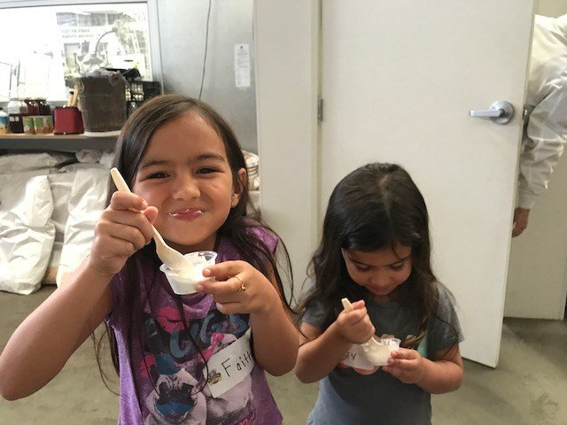 Kids enjoy ice cream during a tour of Doc Burnstein's Ice Cream Lab. (Photo courtesy SLO County Dept. of Social Services)