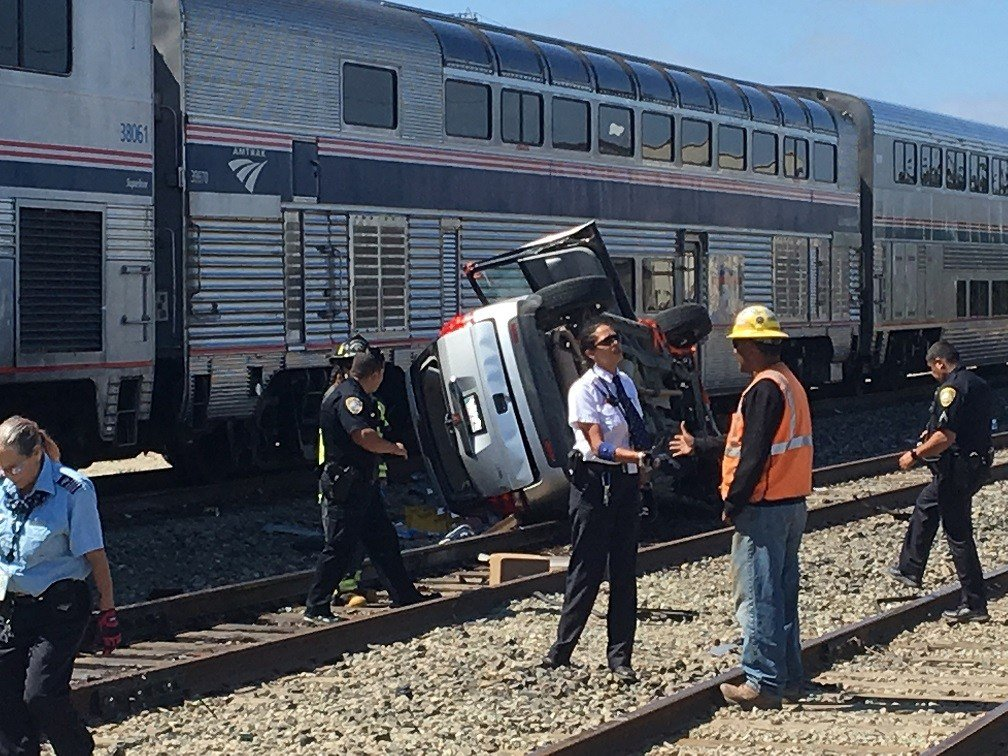 Emergency crews at the scene of a crash involving an SUV and an Amtrak train in Guadalupe. (KSBY photo)