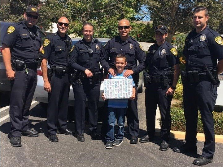 Santa Maria police officers replaced a young boy's stolen birthday presents. (Photo courtesy Santa Maria Police Dept./Twitter)