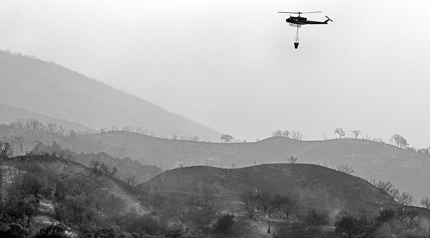 A helicopter makes a drop on the Whittier Fire. (Photo: Mike Eliason/SB Co. Fire)