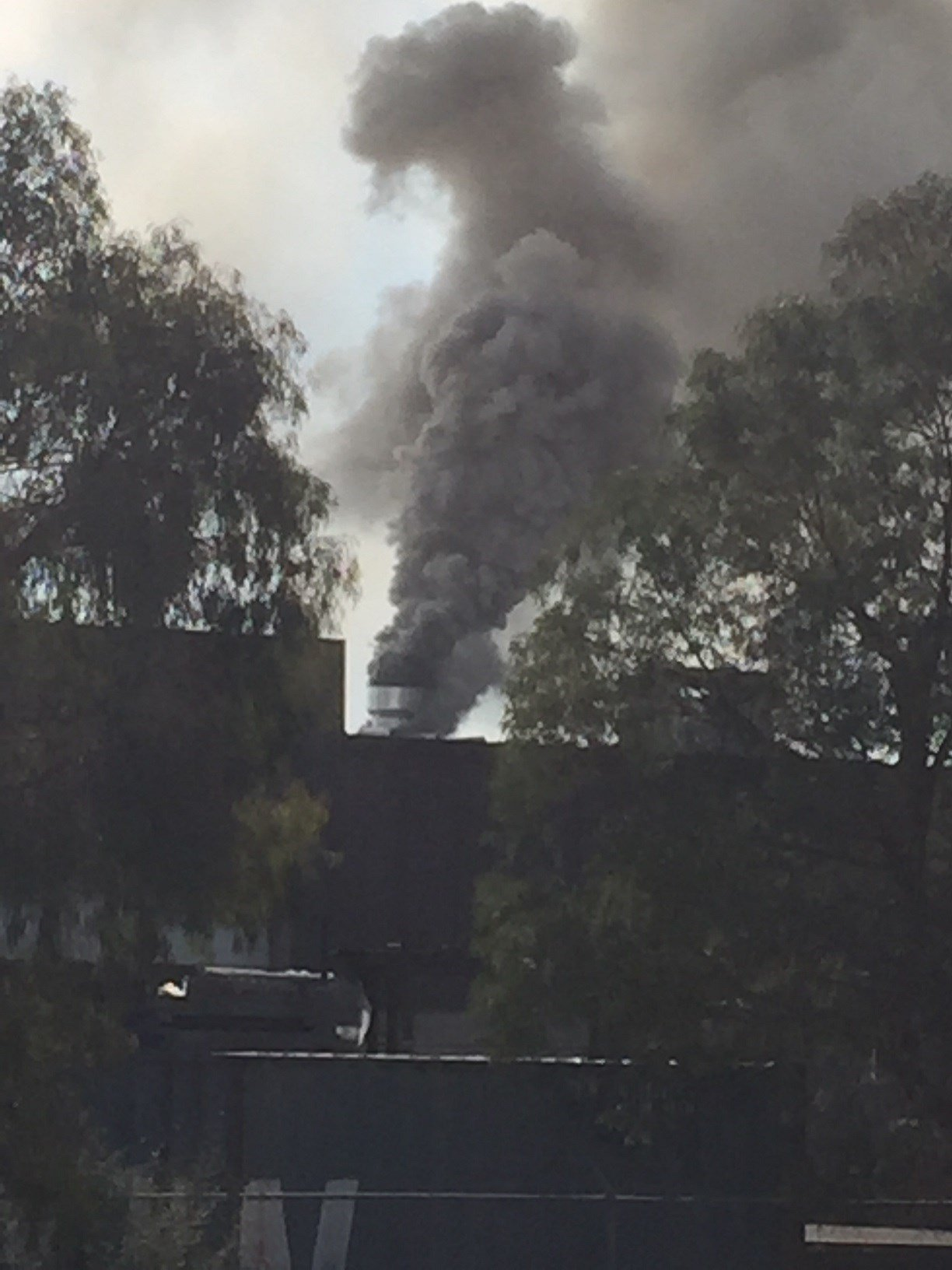 Smoke is seen coming from the Lindamar Industries building in Paso Robles. (Photo courtesy Betsy King)