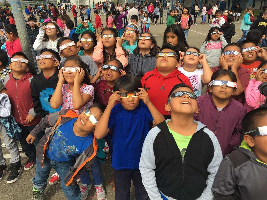 Students at Adam Elementary School in Santa Maria watch the solar eclipse. (KSBY photo)