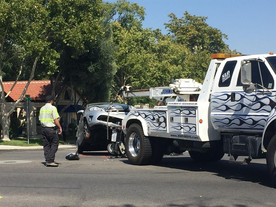 A car involved in a crash with a motorcycle is hauled away in Paso Robles. (KSBY photo)