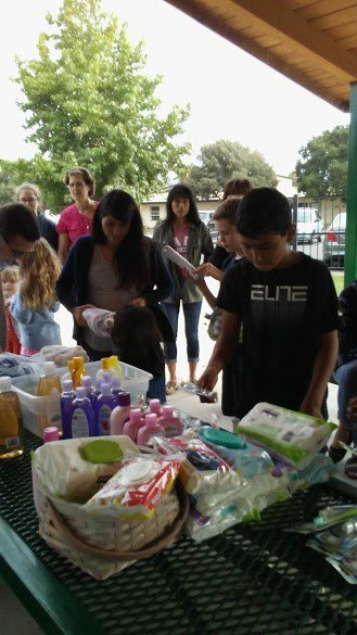 Children collect donations for Angels Foster Care. (Photo courtesy Jeff Lind)