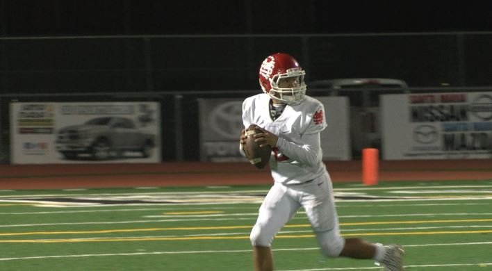 Santa Maria quarterback Blake Truhitte scrambles in the Saints' Week 4 loss at Pioneer Valley