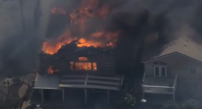 A home burns in the Canyon 2 Fire east of Anaheim. (NBC photo)