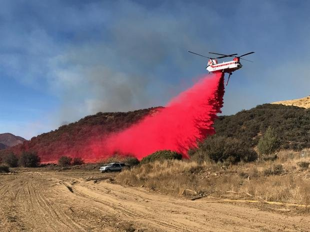 Helicopter drops retardant near a firing operation 12/19/20 (Los Padres National Forest Photo)