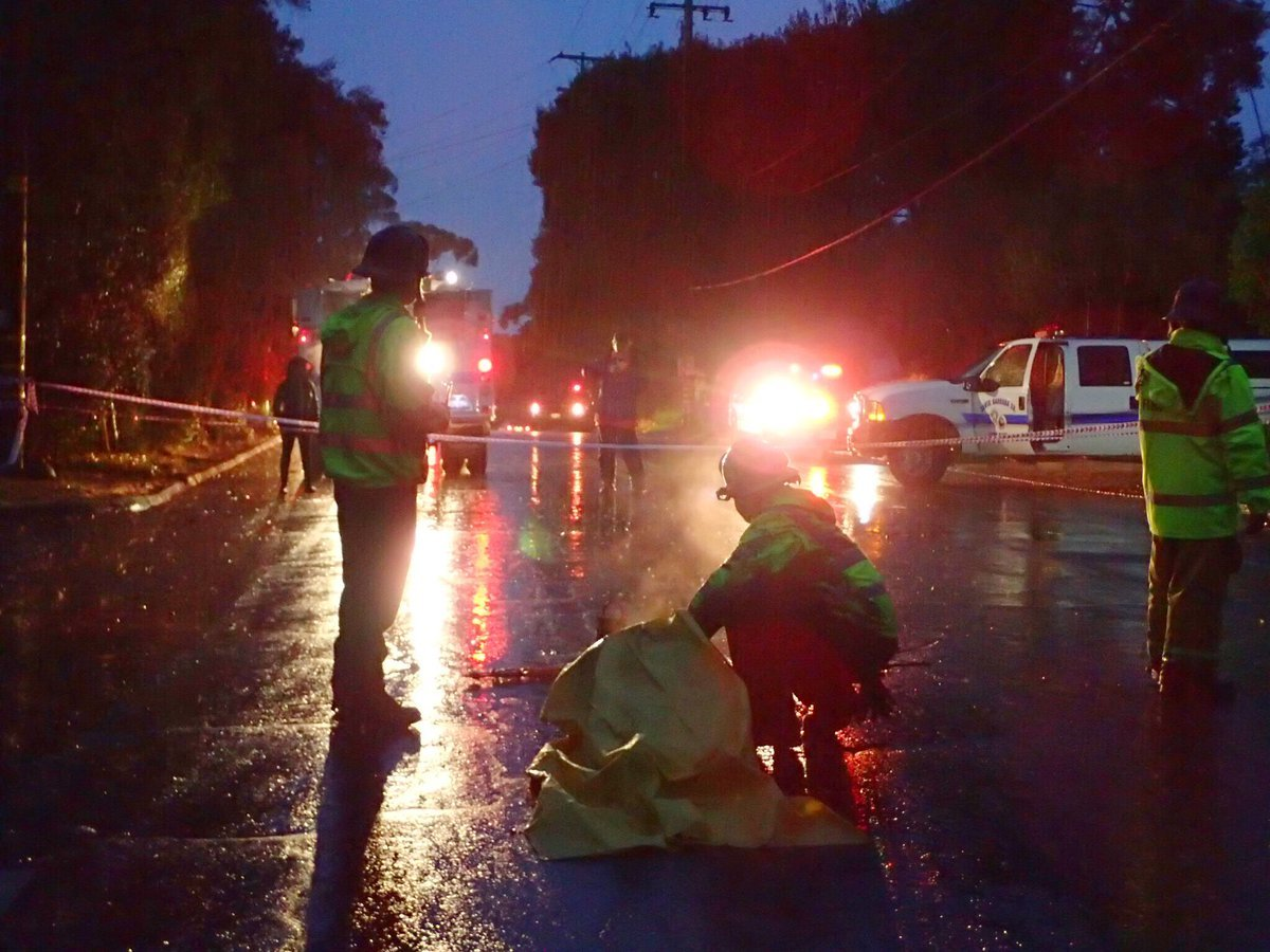 Fierfighters rescued a woman from a debris pile along Hot Springs Road in Montecito early Tuesday morning. (SB Co. Fire photo)