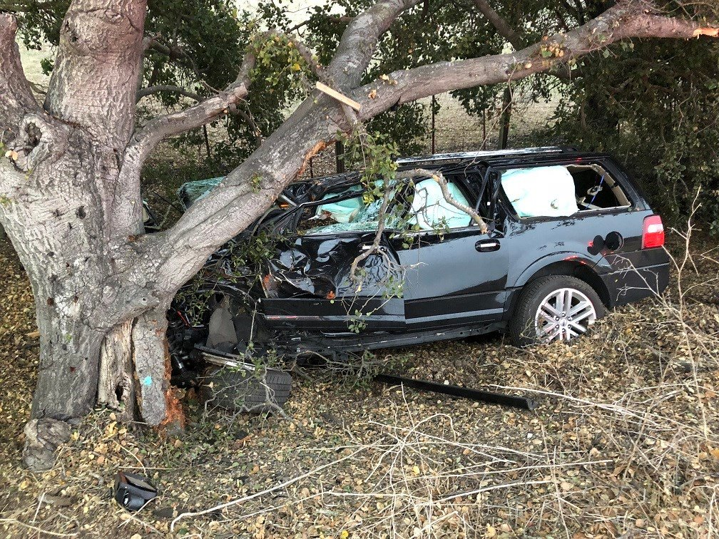 An SUV went off the roadway and crashed into a tree along the northbound lanes of Highway 101. (KSBY photo)