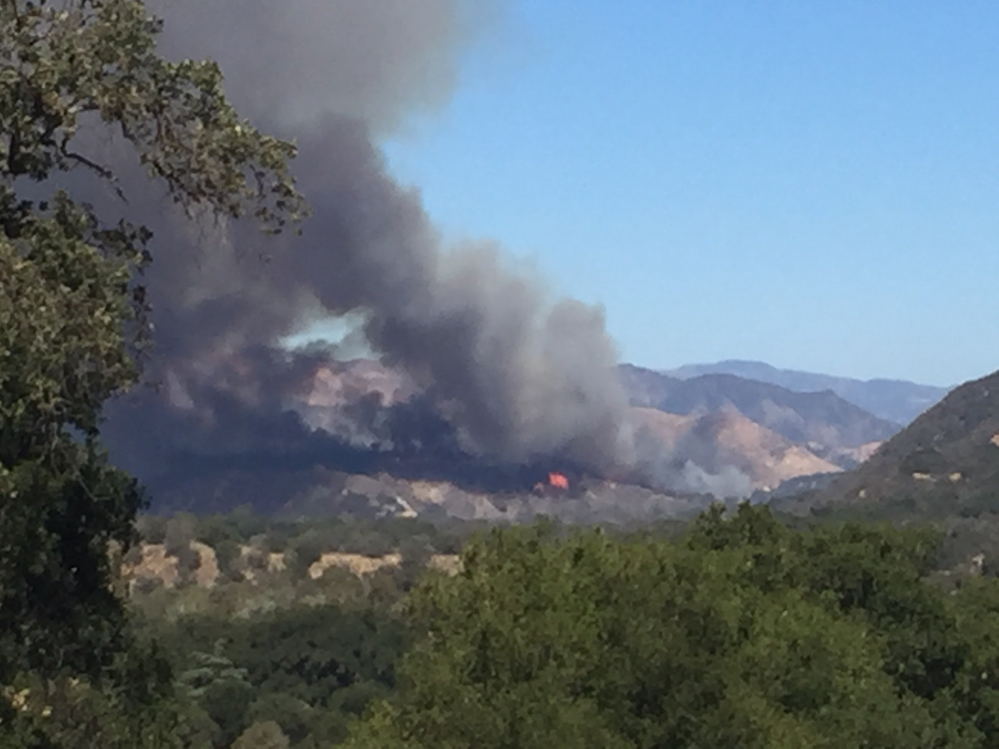Smoke and flames from the Rey Fire Thursday afternoon. (KSBY)