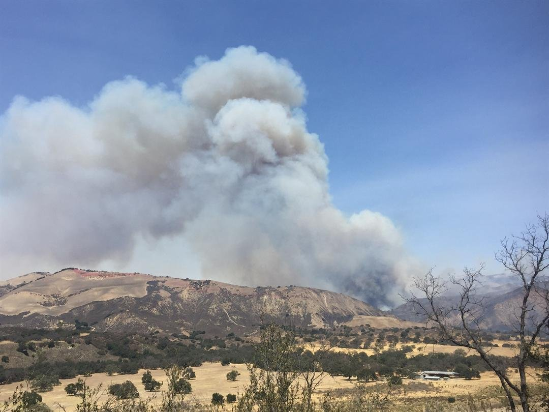 A large plume of smoke is seen Friday from the Rey Fire. (KSBY)